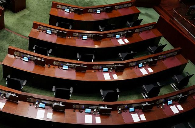 FILE PHOTO: Empty seats of pro-democracy lawmakers are seen during Hong Kong Chief Executive Carrie Lam's annual policy address at the Legislative Council in Hong Kong, China November 25, 2020.