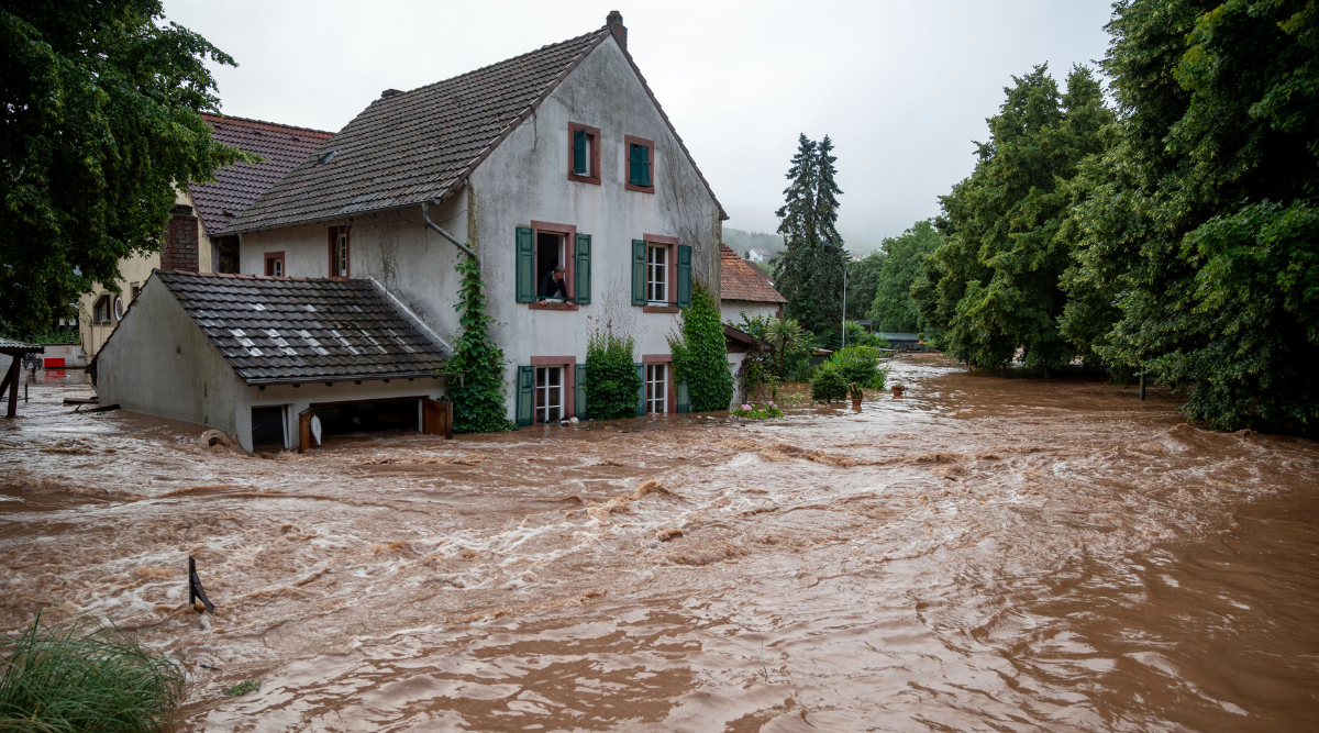 Houses are submerged on the overflowed river banks in Erdorf, Germany, as the village was flooded on Thursday.